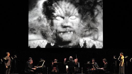 "Philip Glass Emsemble performing ""La Belle et La Bete."""