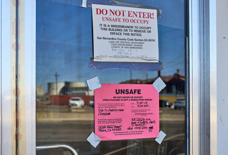 Earthquake damage notice.   Osceola Refetoff