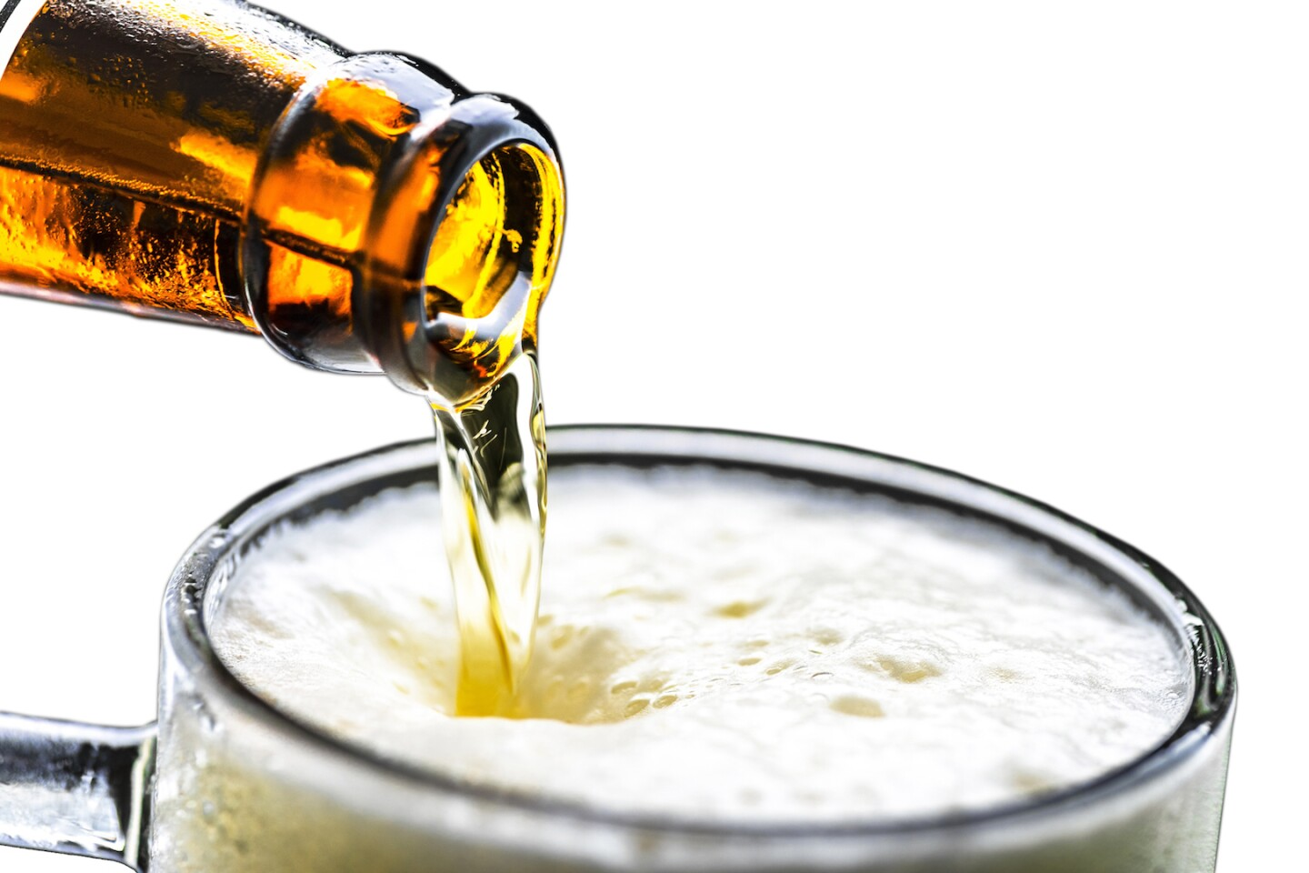 Pouring beer from bottle to glass | Credit: sezer ozger, iStock