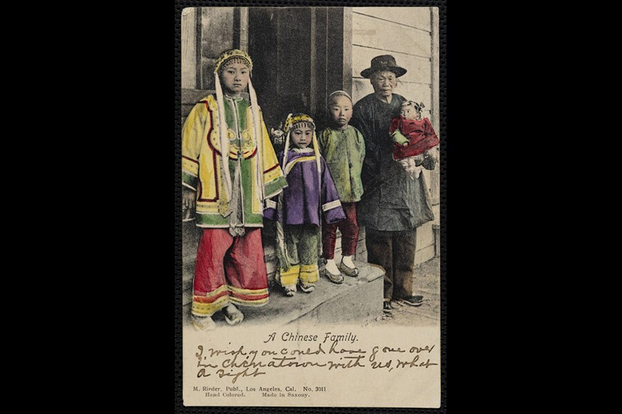 """A color postcard reads """"A Chinese Family"""" and shows an elderly man, a woman and three children in traditional clothing."""