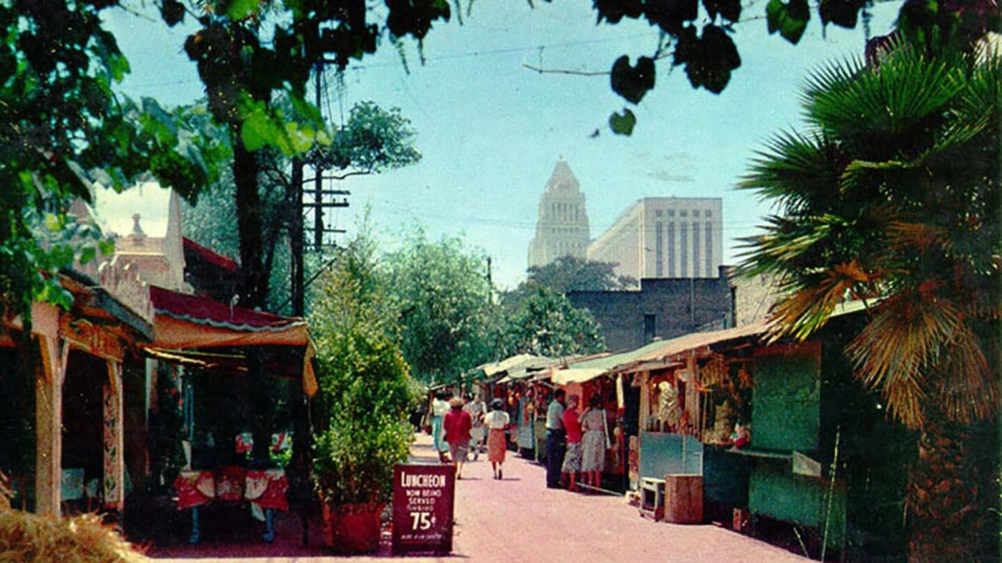 Olvera Street postcard with City Hall in the background from the Security Pacific National Bank Collection | Los Angeles Public Library Olvera Street