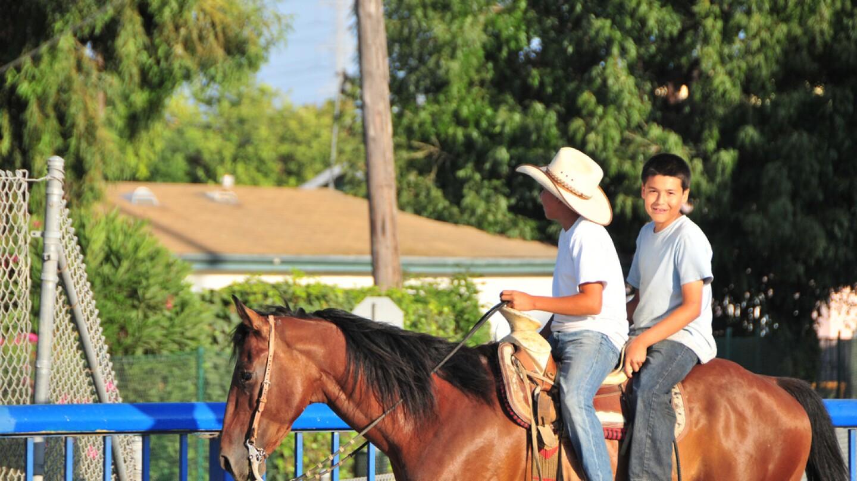 richland_farms_boys_on_a_horse.jpg