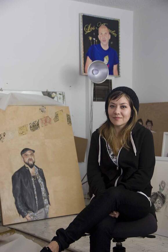 Shizu Saldamando sits inside her studio.