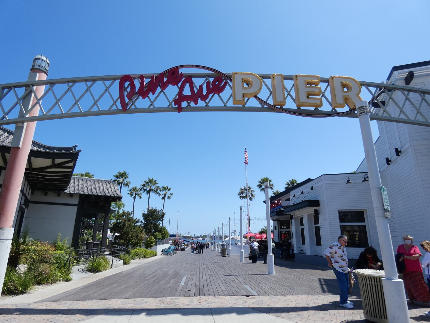 A sign for Pine Ave Pier in Long Beach, California.