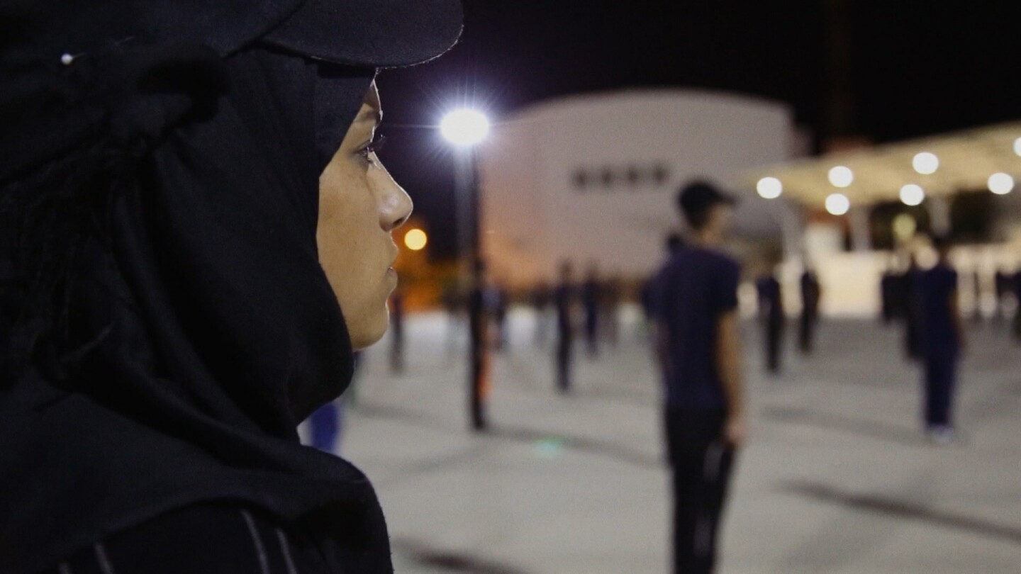 "Walaa looks focused during police training to join the Palestinian Security Forces. | ""Link Voices: What Walaa Wants."""