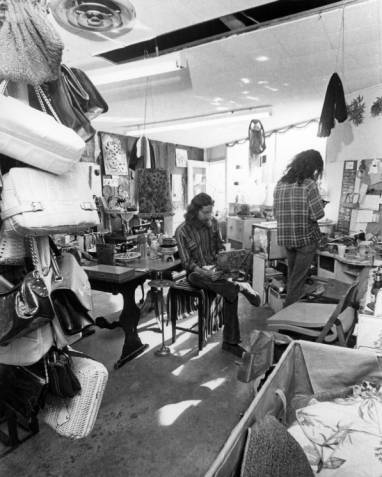 Stanley Williams (sitting) was the shop manager for the Gay Community Services Center Gaywill Funky Shoppe, circa 1972. | ONE National Gay and Lesbian Archives, USC Libraries
