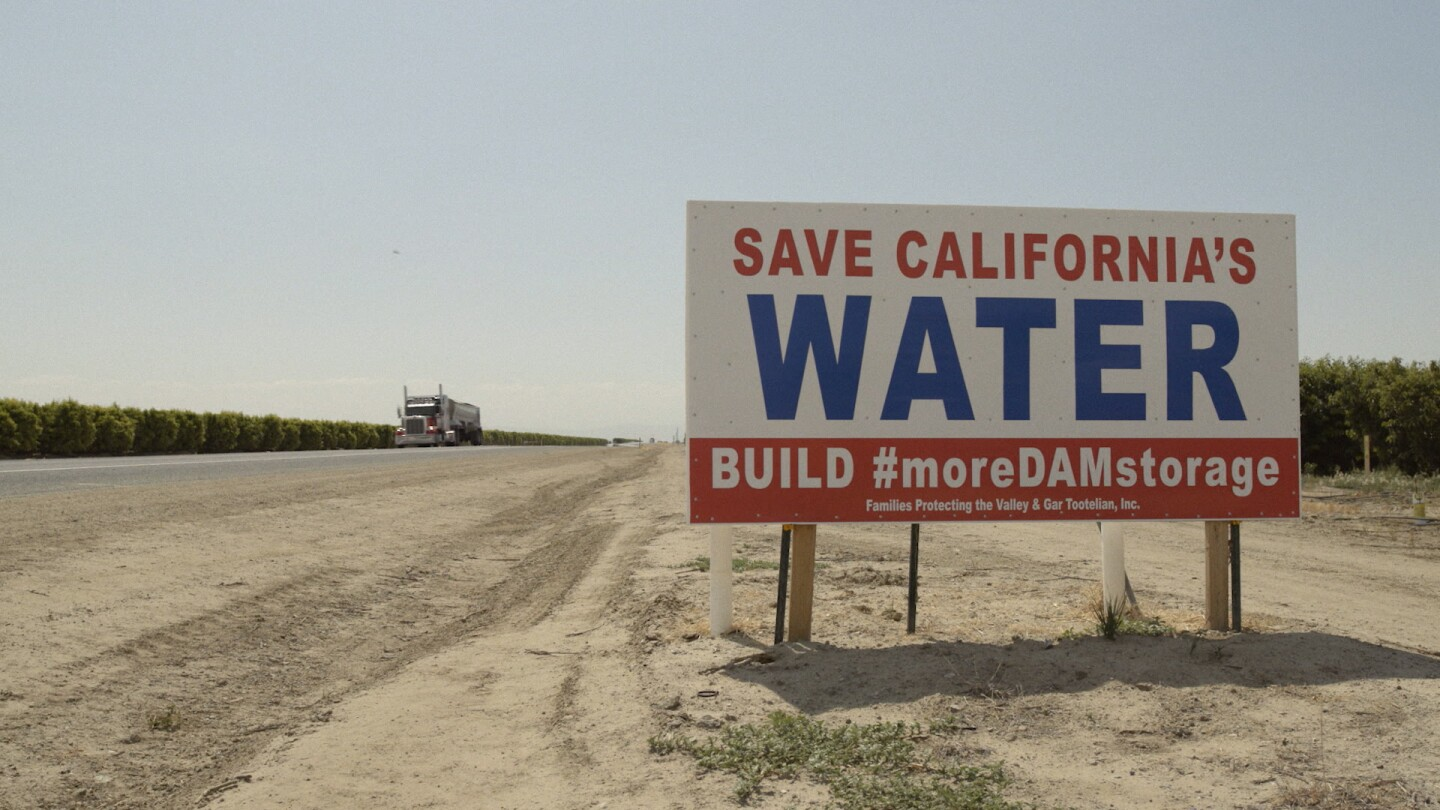"""A sign by the side of the freeway in California asks drivers to """"Save California's Water"""" 