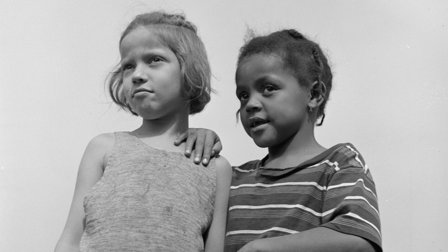 Two children at Camp Christmas Seals in Haverston, New York, 1943, featured in POWER & HEALTH. (Image courtesy of Gordon Parks)