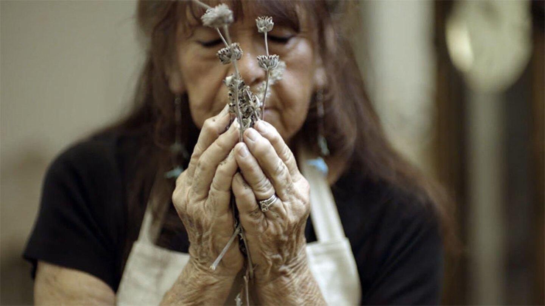 Barbara Drake holding sage
