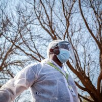 A Phlebotomist with the National Health Laboratory Service is pictured outside the Pudumong Healthcare Centre in the North West Province, South Africa, during a routine visit on September 4, 2020. | Thomson Reuters Foundation/Gulshan Khan
