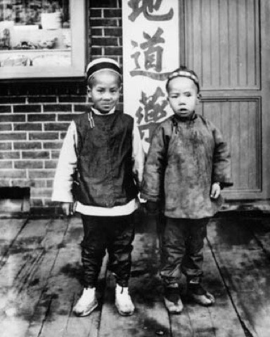 First-generation Chinese Americans Po and Wing, dressed in traditional Chinese clothing.  | Courtesy of the Los Angeles Public Library