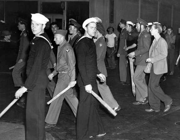 During the riots, sailors, soldiers, and marines roamed the streets of Los Angeles, carrying makeshift weapons like baseball bats and wooden sticks. Courtesy of the Library of Congress.