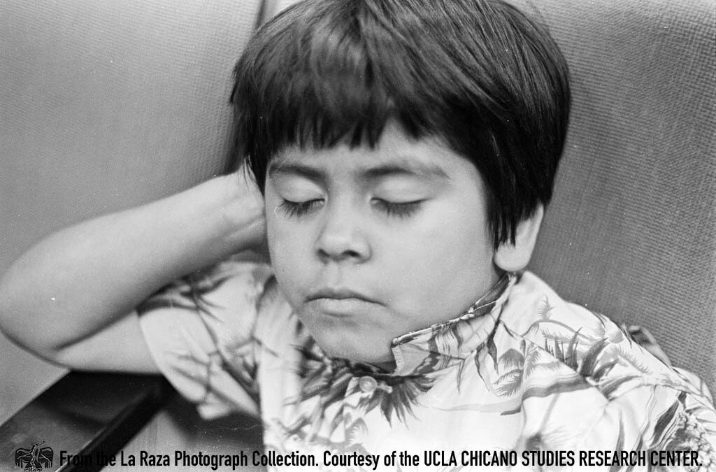 CSRC_LaRaza_B1F7C7_Staff_001 A young boy at a sit-in at the LAUSD Board of Education meeting | La Raza photograph collection. Courtesy of UCLA Chicano Studies Research Center