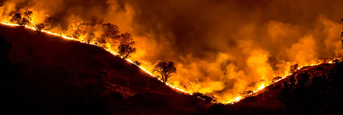 Mountain ridge ablaze in the Woolsey Fire. | Peter Buschmann via Forest Service, USDA