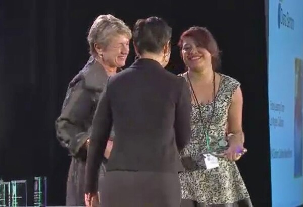 Diana S. accepts her award from the NCWIT | Photo still from NCWIT awards video