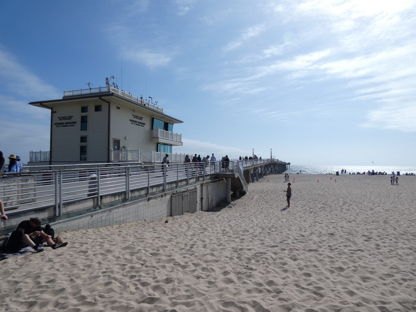 Hermosa Beach Pier made up of now concrete extends out to the beach.