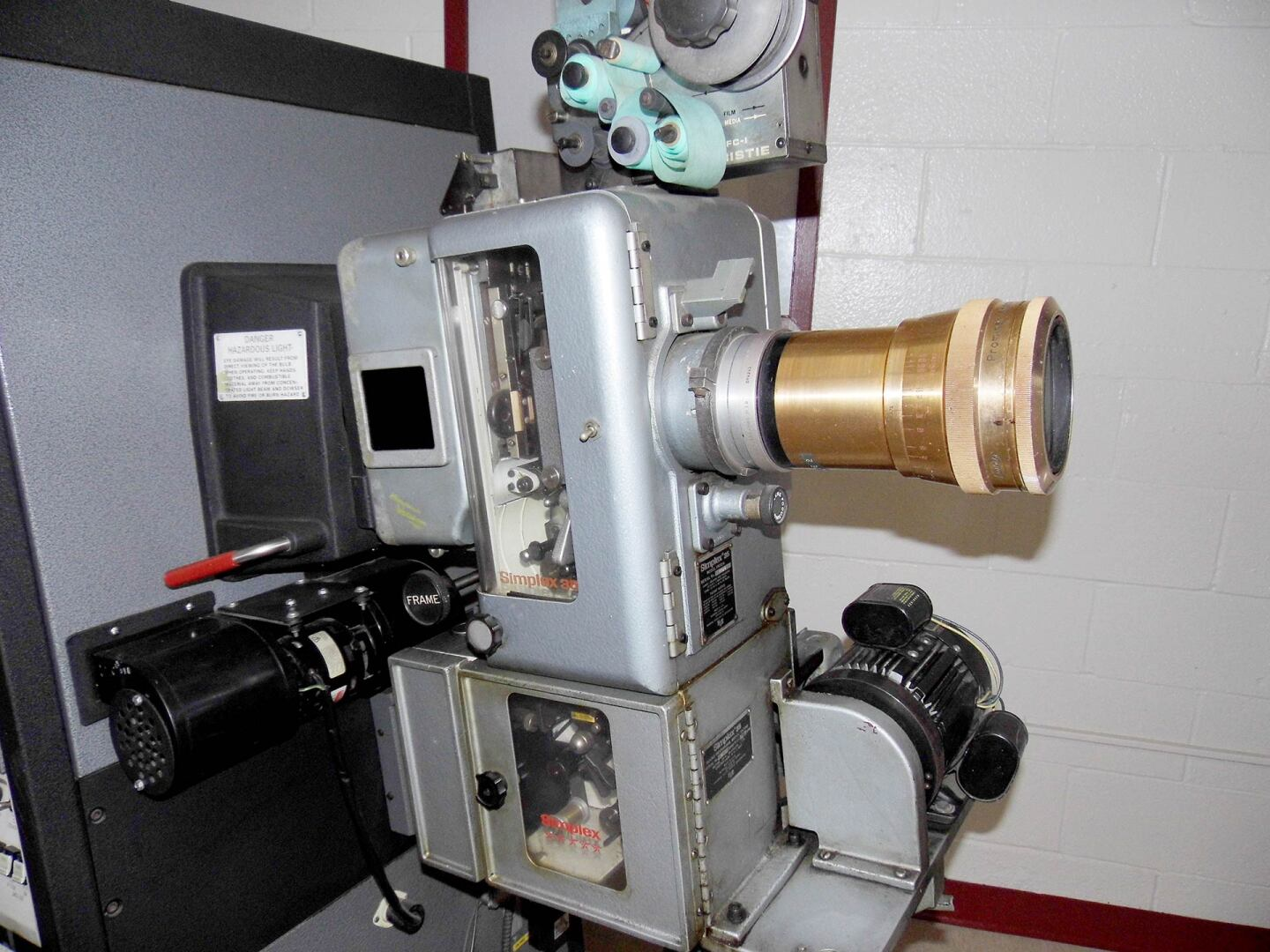Vineland Drive-In's concession stand has son old projection room equipment on display, like a lamp projector, film winder machine and old reels. | Sandi Hemmerlein