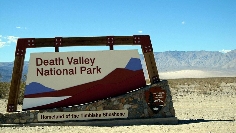 Death Valley NP sign with Timbisha Homeland banner