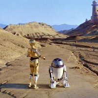 "C-3PO and R2-D2 walk toward Jabba's Palace, which was filmed in Death Valley's Twenty Mule Team Canyon for this scene in ""Episode VI: Return of the Jedi."" Lucasfilm, LTD."