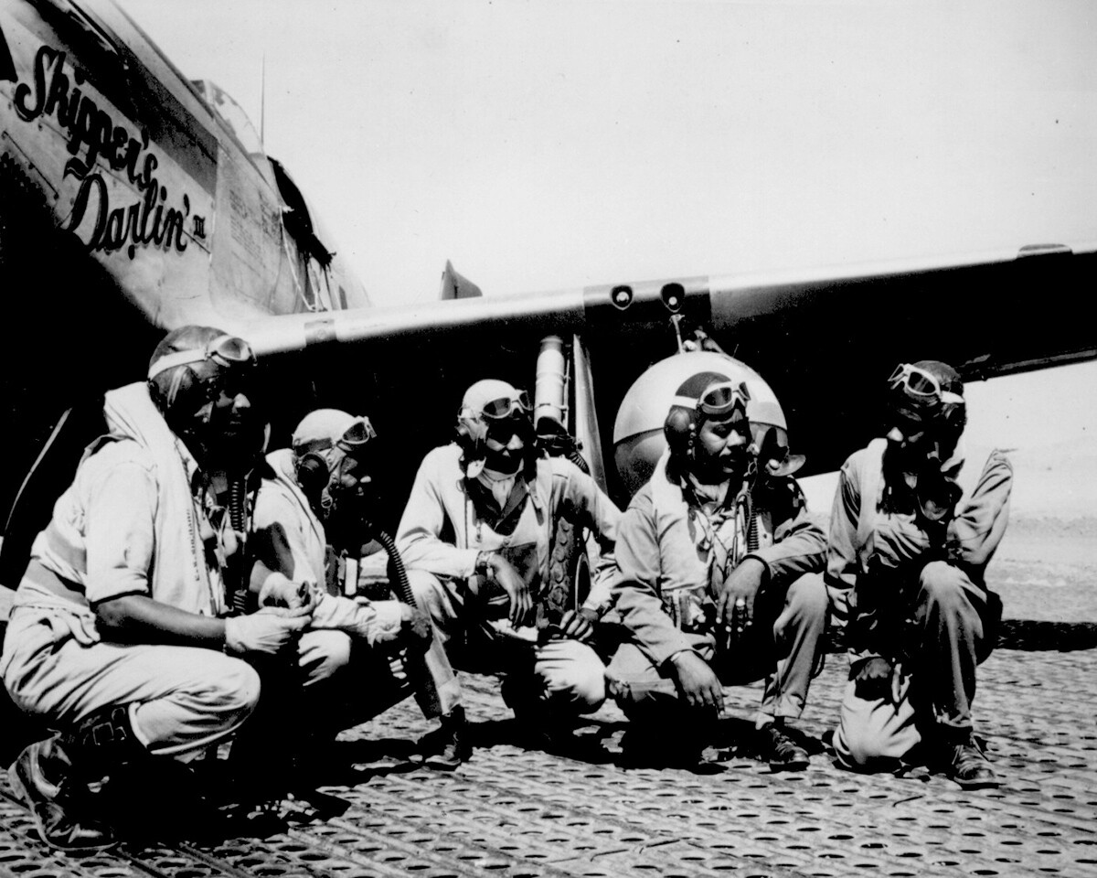 Lt. Dempsey W. Morgan Jr., Lt. Carroll S. Woods, Lt. Robert H. Nelson Jr., Capt. Andrew D. Turner and Lt. Clarence P. Lester in the shadow of a P-51 Mustang in Italy. August 1944. | Courtesy of the National Archives