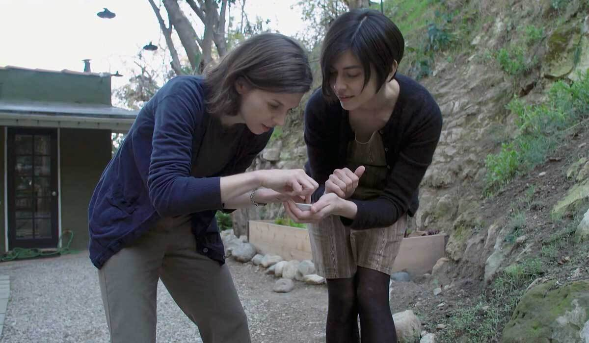 """Jann Vendetti, curator of malacology at the Natural History Museum, with citizen scientist Emily Han. 