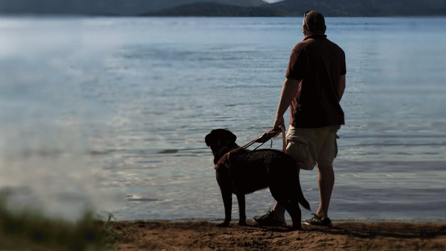 Veteran and dog on a lake | Credit: WMHT