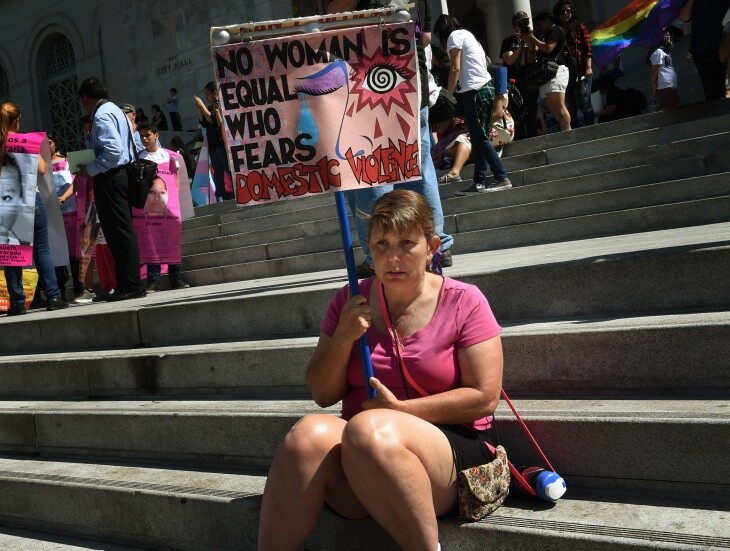 A woman at the 2015 International Women's Day march in L.A. | Mark Ralston/AFP via Getty Images