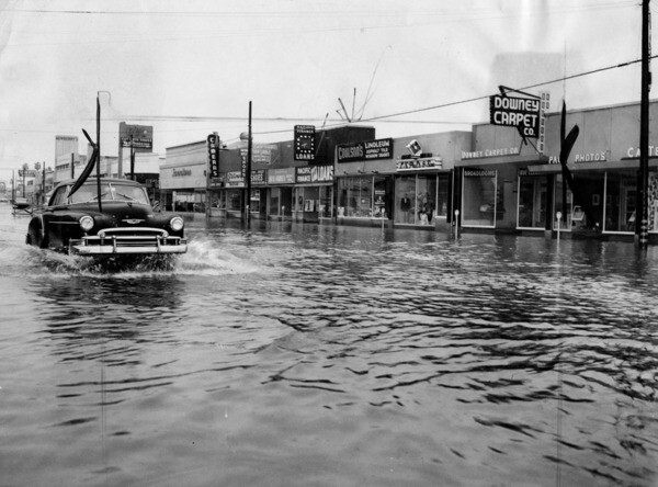 Flooded street in Downey, 1954 | Photo: Herald-Examiner Collection, Los Angeles Public Library