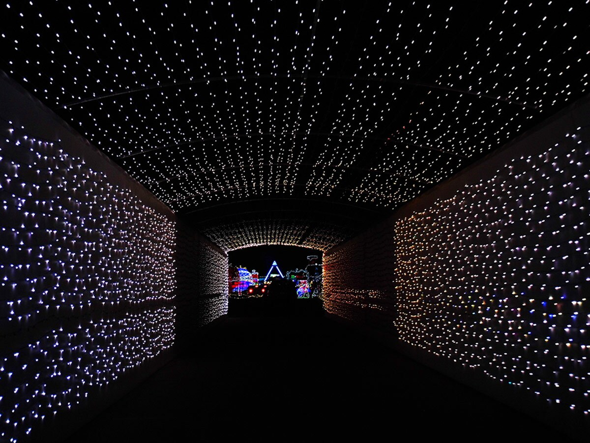 A tunnel of white lights at Night of Lights OC at the OC Fair & Event Center. | Sandi Hemmerlein