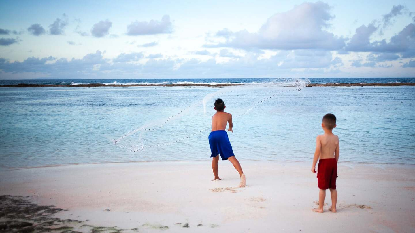 Boys playing by the beach in Guam | Kyle Hausmann-Stokes