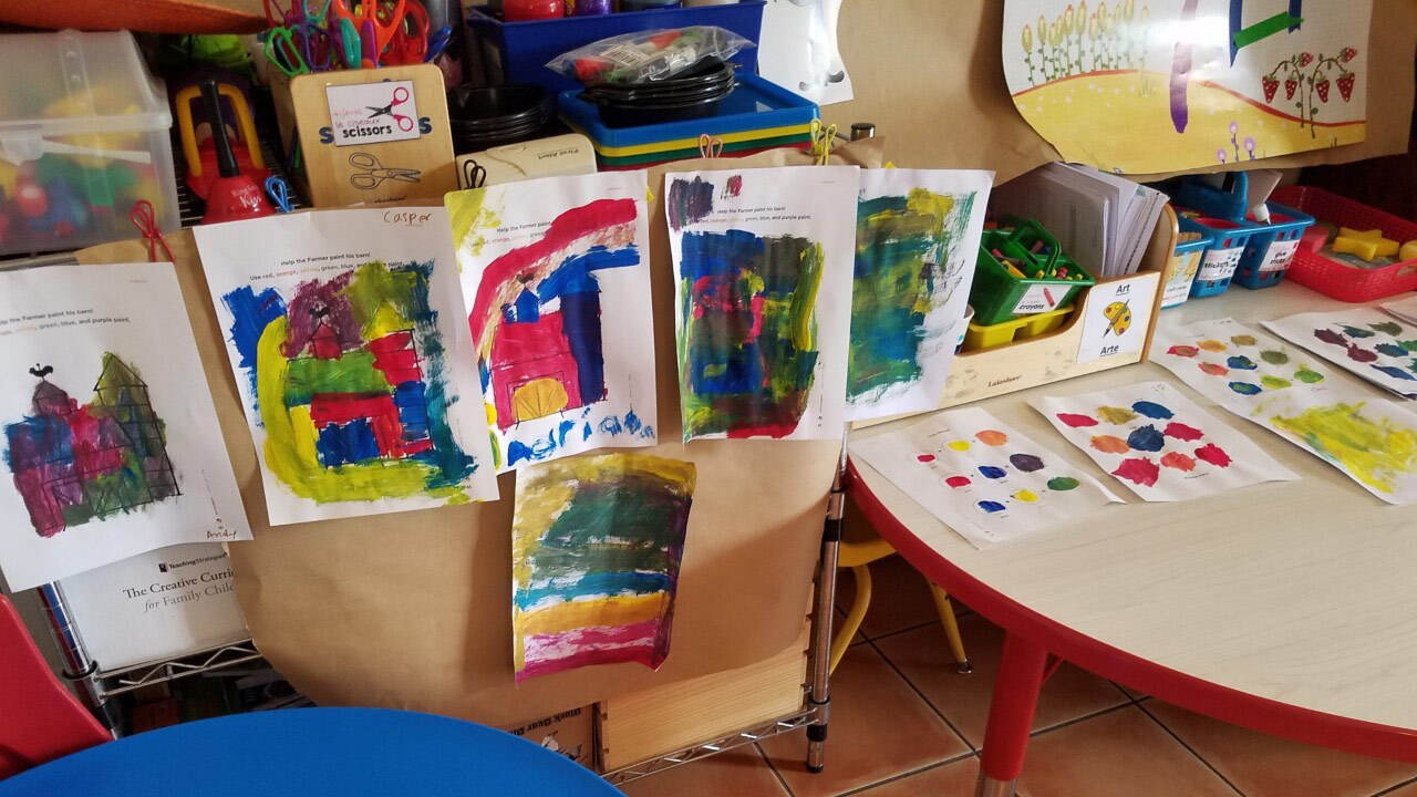 """Children painted colorful barns like the ones seen in """"Peg + Cat"""" as part of the pilot hybrid program."""