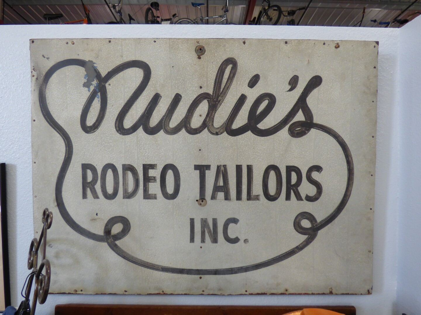 The storefront sign for Nudie's | Henry Cram