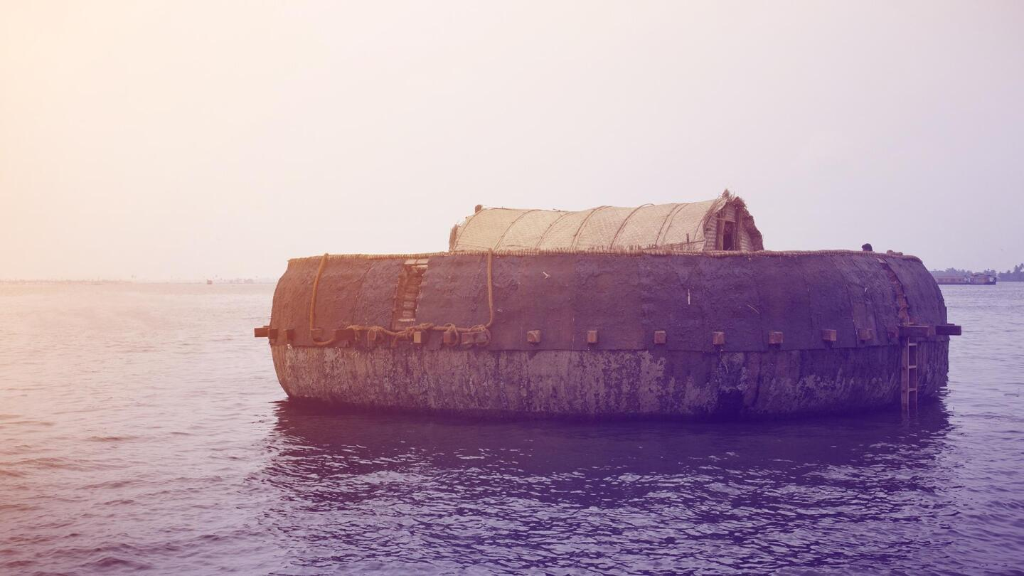"A floating structure rests on a body of water. | ""NOVA: Secrets of Noah's Ark"""