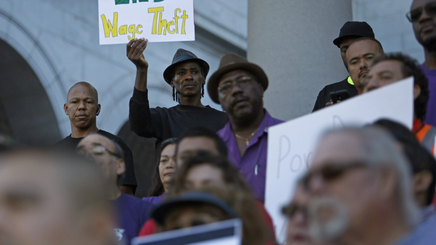 LOS ANGELES, CA - OCTOBER 7, 2014: Labor groups and workers, including John Beard, with the LA Black