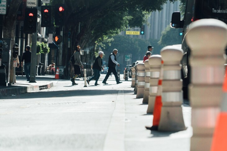 Pedstrians in downtown Los Angeles, prior to coronavirus physical distancing guidelines. | Al Kamalizad for LAist