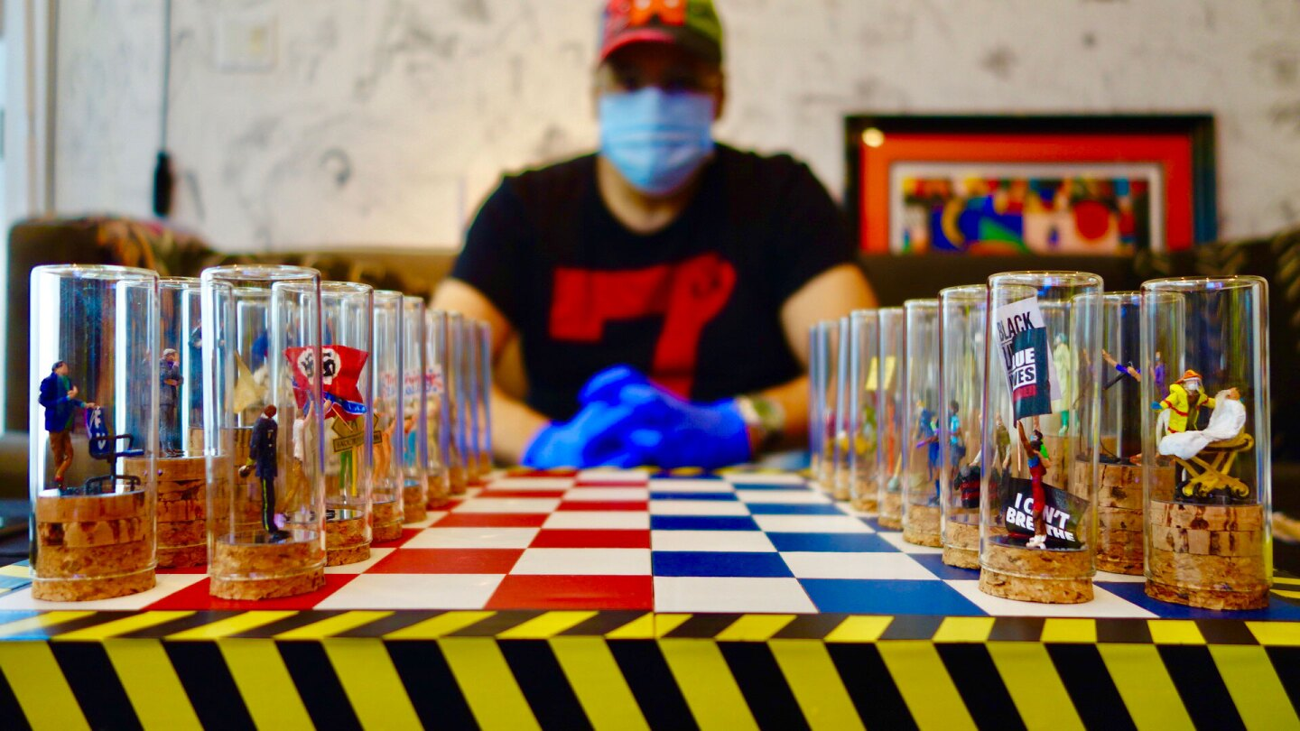 """""""Covid Chess Set"""" by Lyndon J. Barrois, Sr. features two sides: the personas of the powerful virus and incompetent politics (red side) or the heroic and vulnerable first responders and victims (blue side).   Courtesy of Lyndon Barrios, Sr."""