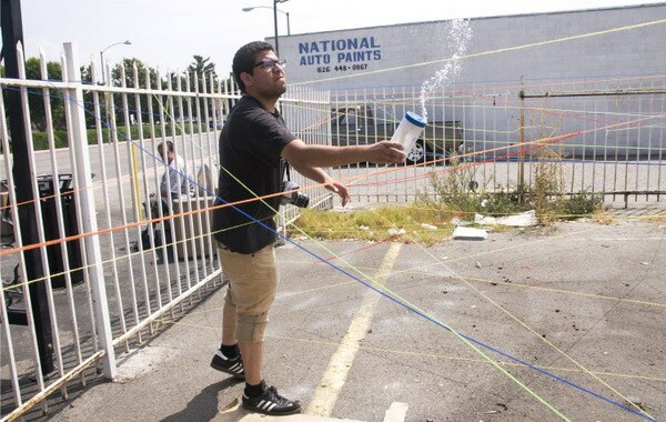 Christopher Anthony Velasco installing 'Let It Sparkle'   Photo by Lester Lawenko/SEMAP