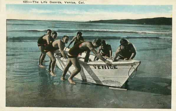 Before paddleboards, heavy dory boats were one of the few options available to lifeguards for rescuing swimmers at sea. Courtesy of the Loyola Marymount University Library's Werner Von Boltenstern Postcard Collection.