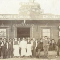7 Mile House circa June 1904. Original owner, Egidio Micheli, center with apron, with partner, Palmiro Testa (right). Lady on the far right back holding baby Ecle is Niccola Testa. Little girl on far right is Eva Testa | Courtesy of 7 Mile House