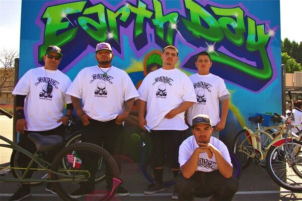 At one of the route stops, members of Los Ryderz pose in front of the Earth Day Mural at Normandie Avenue Elementary School, site of a CSU community garden and Earth Day 2013 on April 6th | Photo by Sahra Sulaiman
