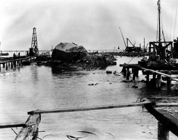 Dredgers chip away at the last remnants of Dead Man's Island in 1928. Courtesy of the Security Pacific National Bank Collection - Los Angeles Public Library.