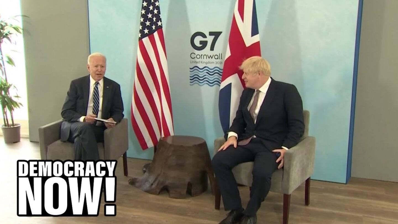 President Biden sitting beside Prime Minister Boris Johnson at the G7 Summit.