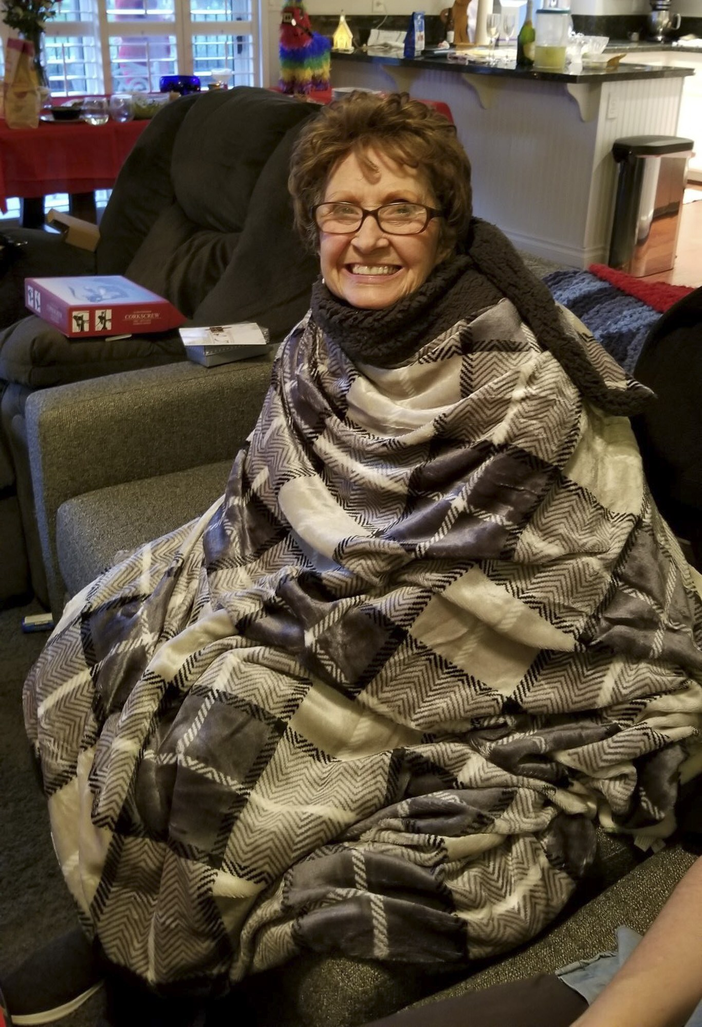 Barbara Franklin, who has terminal cancer caused by asbestos exposure, wears a blankie wrapped around herself.