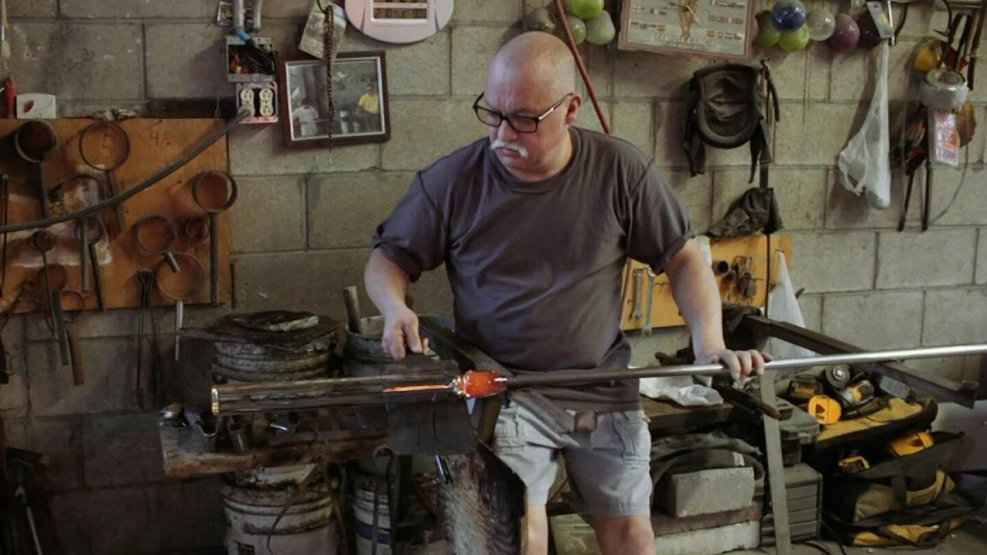 "Still image from Artbound's ""Artesanos/Artisans"" of glass maker Jesus Garcia"