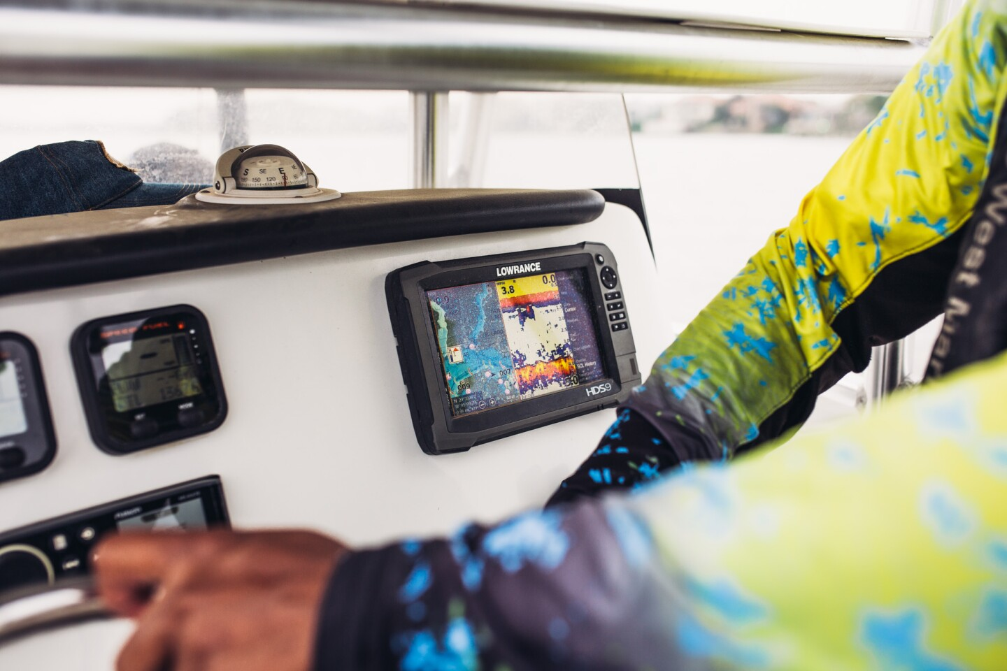 Through real-time sonar, Captain Fred searches for where fish congregate.