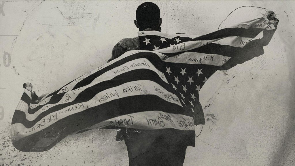 """An illustration of a man holding the American flag behind his back. 