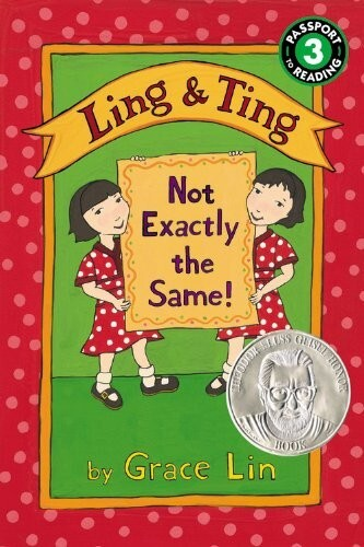 "Book cover of Ling and Ting: Not Exactly the Same!"" by Grace Ling. The name of the book is bordered by two illustrations of similar looking girls in red dresses"