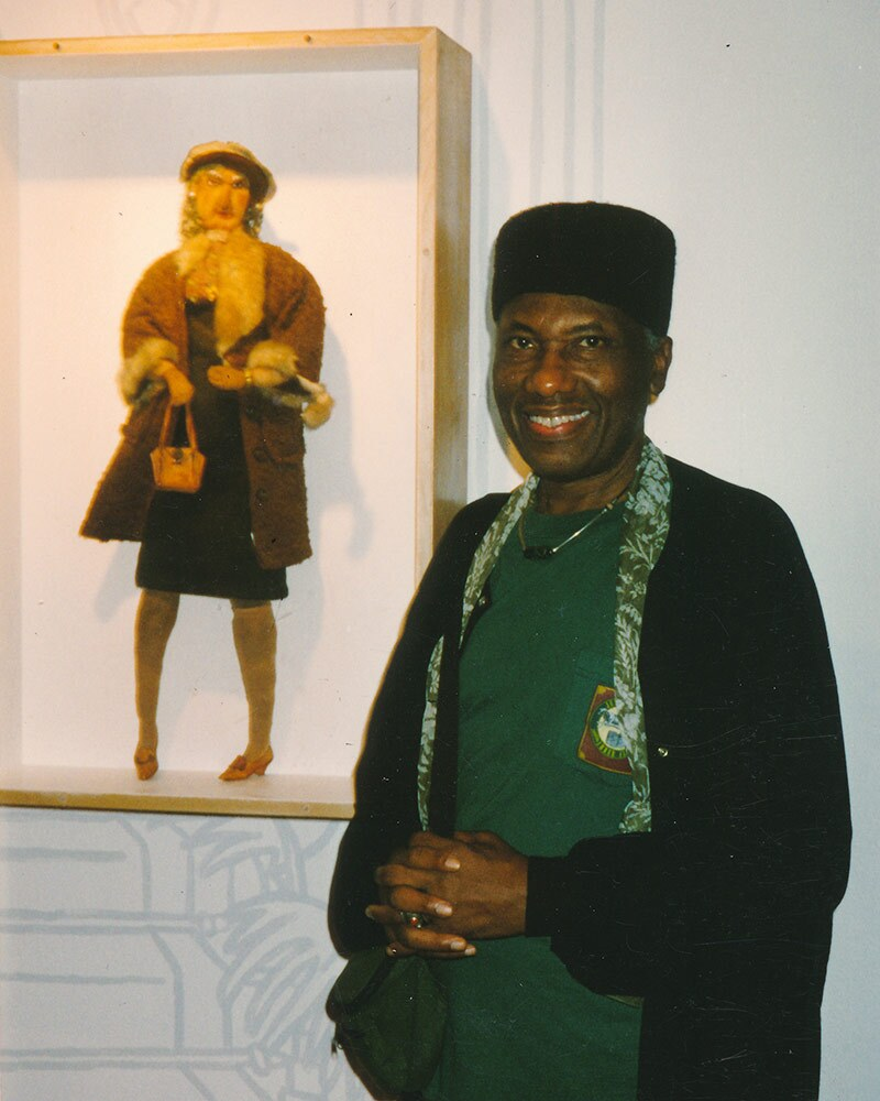 John Outterbridge and artwork at a William Grant Still Art Center Black Doll Show in the late 80s. | Bobbie Campbell, Courtesy of William Grant Still Art Center
