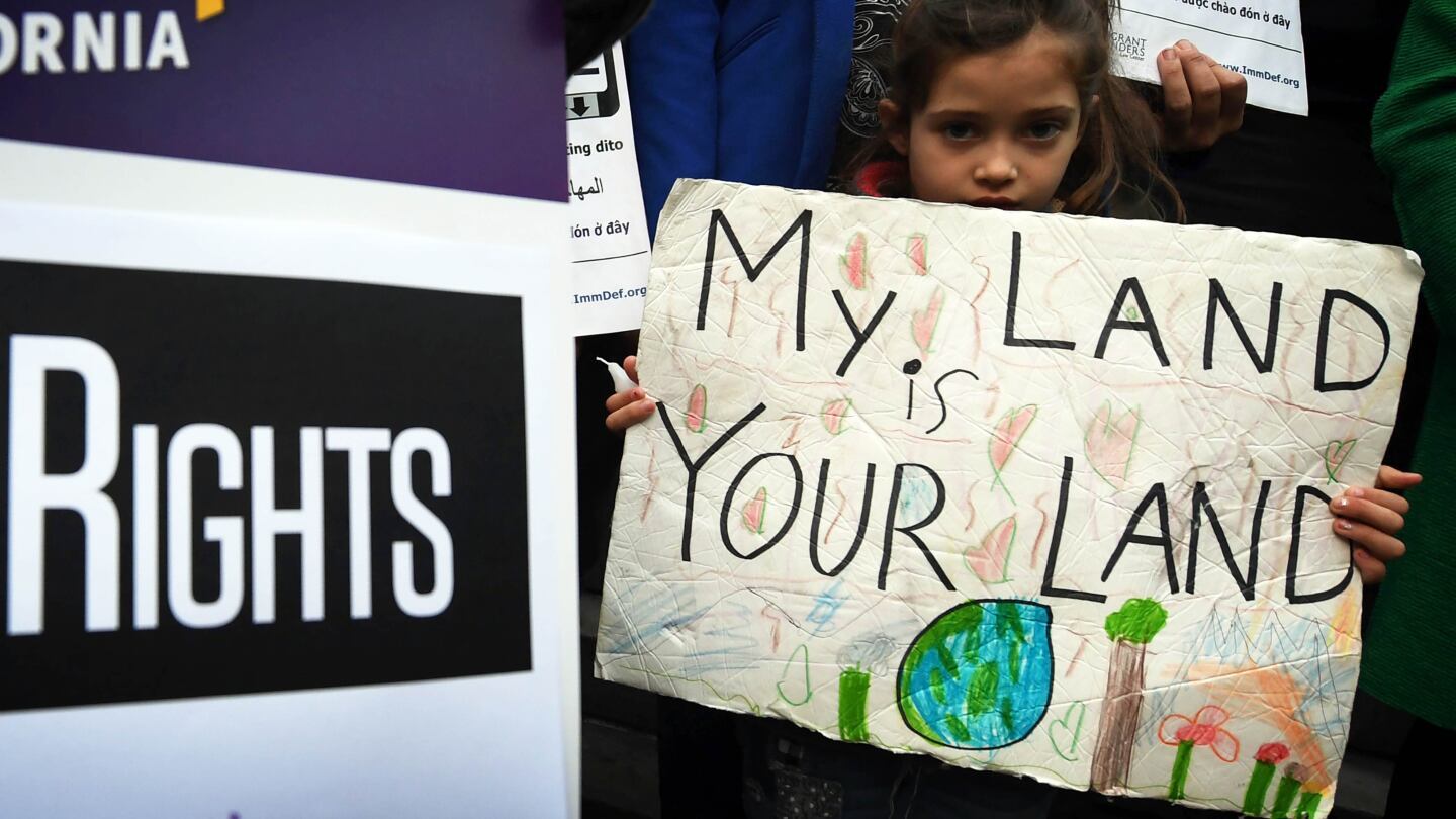 Maya Casillas, 7, joins migrant rights group during a protest against Pres. Trump's new immigration policies outside L.A. City Hall, Jan. 25, 2017 | photo MarkRalston/AFP/Getty Images