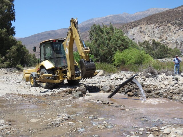 The government of Petorca and water defender organization MODATIMA unearthed a hidden pipeline syphoning water away from the river for a large plantation nearby. | Courtesy of Municipalidad de Petorca